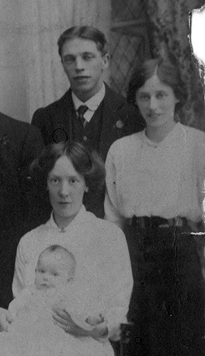 Percy in 1915, stood next to his sister and behind his wife
